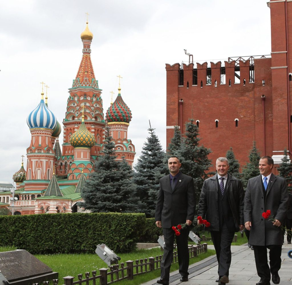 With St. Basil's Cathedral providing a fitting backdrop, the Expedition 33/34 prime crewmembers arrive at the Kremlin Wall in Moscow's Red Square September 25, 2012 to conduct the traditional laying of flowers at the site where Russian space icons are interred, including Yuri Gagarin, the first human to fly in space, and Sergei Korolev, Russia's Great Designer. From left to right are Russian Flight Engineer Evgeny Tarelkin, Soyuz Commander Oleg Novitskiy and NASA Flight Engineer Kevin Ford. The trio will launch October 23 from the Baikonur Cosmodrome in Kazakhstan in their Soyuz TMA-06M spacecraft for a five-month mission on the International Space Station. NASA/Stephanie Stoll jsc2012e217521