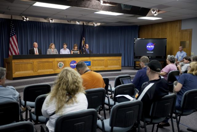 CAPE CANAVERAL, Fla. -- News and social media representatives participate in a space station and mission science briefing in NASA Kennedy Space Center's Press Site auditorium in Florida. On the dais from left are Michael Curie, NASA Public Affairs, Julie Robinson, program scientist for International Space Station at NASA's Johnson Space Center, Timothy Yeatman, interim chief scientist at the Center for the Advancement of Science in Space, Sheila Nielsen-Preiss, cell biologist at Montana State University, and Scott Smith, NASA nutritionist at NASA's Johnson Space Center.     The briefing provided media with an overview of the experiments and payloads scheduled for launch on NASA's first Commercial Resupply Services, or CRS-1, mission to the International Space Station. Space Exploration Technologies Corp., or SpaceX, built both the mission's Falcon 9 rocket and Dragon capsule. Launch is scheduled for 8:35 p.m. EDT on Oct. 7 from Space Launch Complex 40 on Cape Canaveral Air Force Station.  SpaceX CRS-1 is an important step toward making America's microgravity research program self-sufficient by providing a way to deliver and return significant amounts of cargo, including science experiments, to and from the orbiting laboratory. NASA has contracted for 12 commercial resupply flights from SpaceX and eight from the Orbital Sciences Corp. For more information, visit http://www.nasa.gov/mission_pages/station/living/launch/index.html.  Photo credit: NASA/Kim Shiflett KSC-2012-5686
