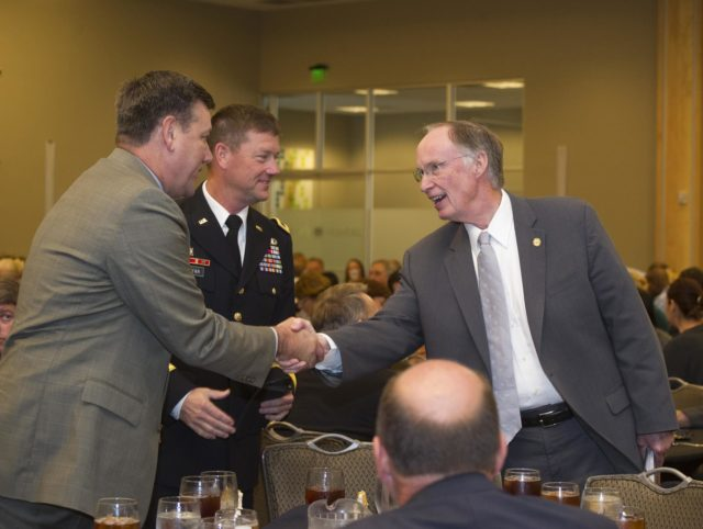 ALABAMA GOV. ROBERT BENTLEY, RIGHT, CONGRATULATES MARSHALL CENTER DIRECTOR PATRICK SCHEUERMANN, LEFT, AND U.S. ARMY MAJ. GEN. LYNN COLLYAR, COMMANDING GENERAL OF THE U.S. ARMY AVIATION & MISSILE COMMAND, FOR A SUCCESSFUL 50 YEARS OF MISSION SUCCESS AND COLLABORATION IN THE HUNTSVILLE COMMUNITY 1201046