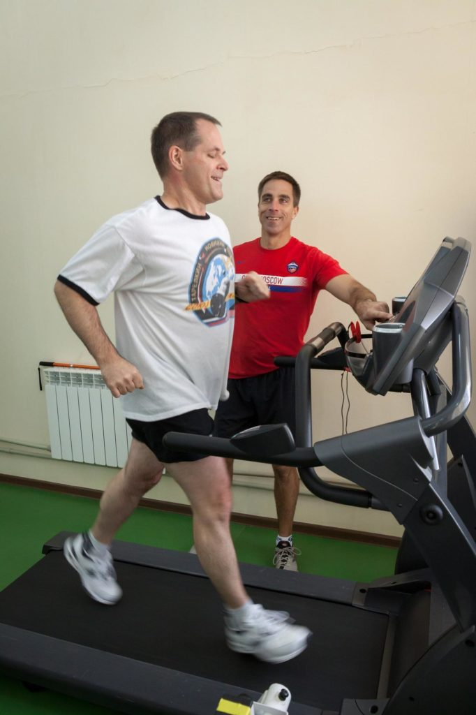 Taking time out from training, Expedition 33/34 Flight Engineer Kevin Ford of NASA works out on a treadmill at the Cosmonaut Hotel crew quarters in Baikonur, Kazakhstan October 17, 2012 under the watchful eye of backup Flight Engineer Chris Cassidy of NASA. Ford, Soyuz Commander Oleg Novitskiy and Flight Engineer Evgeny Tarelkin are preparing for launch October 23 in their Soyuz TMA-06M spacecraft to spend five months on the International Space Station. NASA/Victor Zelentsov jsc2012e221498