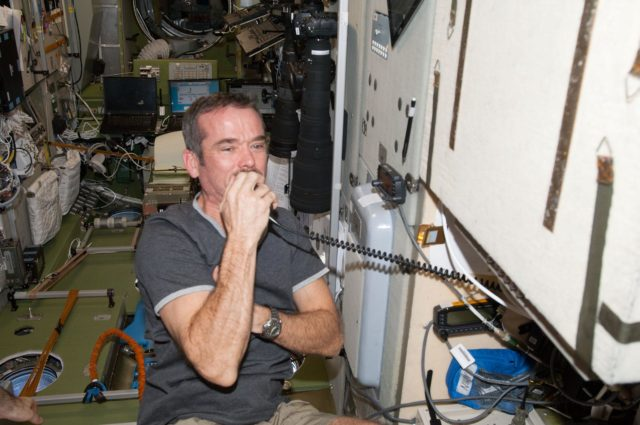 Hadfield during Ham radio session in the SM