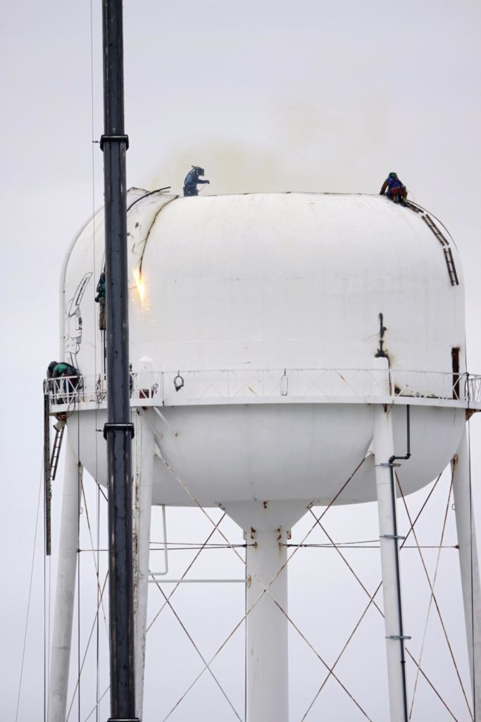 CAPE CANAVERAL, Fla. – Workers use a cutting torch to dismantle a water tower in the Launch Complex 39 area at NASA's Kennedy Space Center in Florida.      The effort is part of on-going efforts to upgrade and revitalize Kennedy's water and sewer systems to increase their reliability, sustainability and capabilities into the 21st century for current and future users. For more information, visit: http://kscpartnerships.ksc.nasa.gov/masterPlan/spaceportConcept.htm Photo credit: NASA/Tim Jacobs KSC-2013-1373