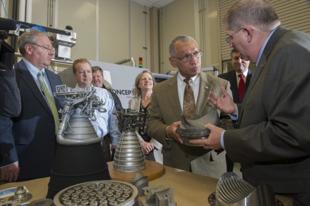 DURING HIS FEB. 22 VISIT TO THE NATIONAL CENTER FOR ADVANCED MANUFACTURING RAPID PROTOTYPING FACILITY AT NASA'S MARSHALL SPACE FLIGHT CENTER, NASA ADMINISTRATOR CHARLES BOLDEN, CENTER, TALKS WITH FRANK LEDBETTER, RIGHT, CHIEF OF THE NONMETALLIC MATERIALS AND MANUFACTURING DIVISION AT MARSHALL, ABOUT THE USE OF 3-D PRINTING AND PROTOTYPING TECHNOLOGY TO CREATE PARTS FOR THE SPACE LAUNCH SYSTEM. ALSO PARTICIPATING IN THE TOUR ARE, FROM BACK RIGHT, MARSHALL CENTER DIRECTOR PATRICK SCHEUERMANN; SHERRY KITTREDGE, DEPUTY MANAGER OF THE SLS LIQUID ENGINES OFFICE; MARSHALL FLIGHT SYSTEMS DESIGN ENGINEER ROB BLACK; AND JOHN VICKERS, MANAGER OF THE NATIONAL CENTER FOR ADVANCED MANUFACTURING. 1300099