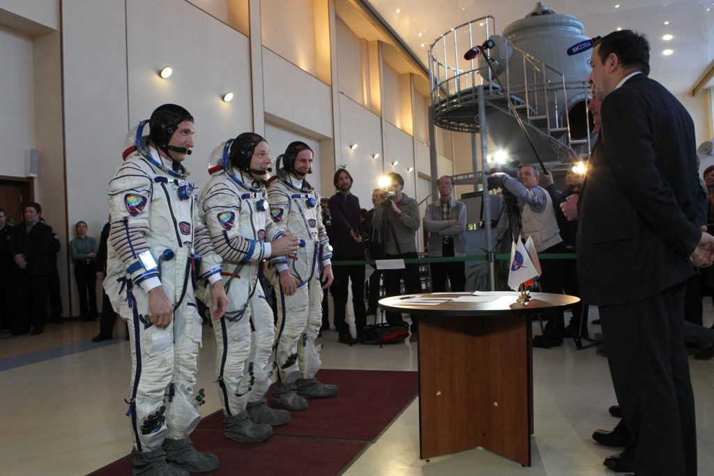 At the Gagarin Cosmonaut Training Center in Star City, Russia, the Expedition 35-36 backup crewmembers are greeted by Russian space officials March 4 as they prepare for a series of qualification simulations in Soyuz and Russian segment trainers. NASA Flight Engineer Michael Hopkins (left), Soyuz Commander Oleg Kotov (center) and Flight Engineer Sergei Ryazanskiy (right) will backup prime crewmembers Chris Cassidy of NASA and Russian cosmonauts Pavel Vinogradov and Alexander Misurkin, who are preparing for launch to the International Space Station March 29 (Kazakh time) from the Baikonur Cosmodrome in Kazakhstan in their Soyuz TMA-08M spacecraft. NASA / Stephanie Stoll jsc2013e013520