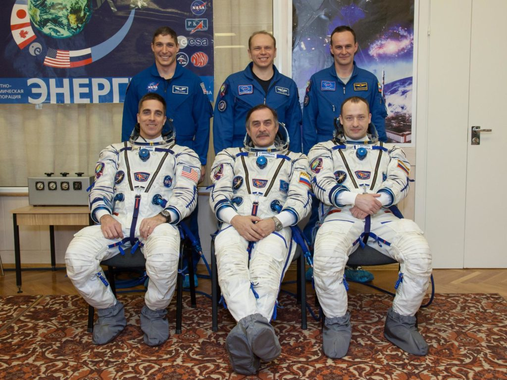 "In the Integration Facility at the Baikonur Cosmodrome in Kazakhstan, the Expedition 35-36 prime and backup crews pose for pictures March 17 during a systems dress rehearsal called a ""fit check"". Left to right in the front row is the prime crew ---  NASA Flight Engineer Chris Cassidy, Soyuz Commander Pavel Vinogradov and Flight Engineer Alexander Misurkin. Left to the right in the back row are backup crewmembers Michael Hopkins of NASA, Oleg Kotov and Sergey Ryazanskiy. Cassidy, Vinogradov and Misurkin are preparing for launch to the International Space Station from Baikonur on March 29, Kazakh time.  NASA/Victor Zelentsov jsc2013e017255"