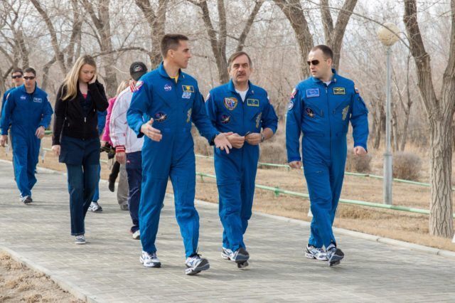 At their Cosmonaut Hotel crew quarters in Baikonur, Kazakhstan, Expedition 35-36 Flight Engineer Chris Cassidy of NASA (left), Soyuz Commander Pavel Vinogradov (center) and Flight Engineer Alexander Misurkin (right) stroll down the Walk of Cosmonauts March 21 as they continue their training for launch to the International Space Station March 29, Kazakh time, in their Soyuz TMA-08M spacecraft from the Baikonur Cosmodrome. The trio will spend 5 ½ months in orbit. Pictured in the rear left of the picture is Cassidy's backup, Michael Hopkins of NASA.  NASA/Victor Zelentsov jsc2013e018006