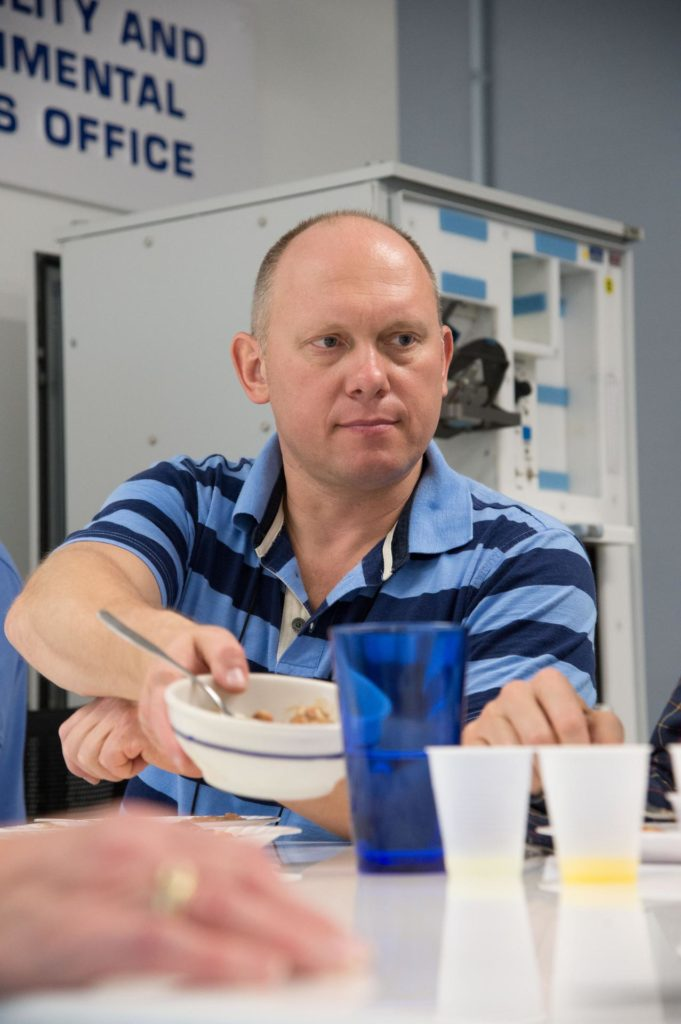 PHOTO DATE:  04-26-13 LOCATION: Bldg. 17, Rm 1070 - Food Lab   SUBJECT: Soyuz 38 (Expedition 39/40) crew members Alexander Skvortov and Oleg Artemiev during food tasting in JSC Food Lab. Photograph cosmonauts individually, with food lab personnel, together, etc. PHOTOGRAPHER: BILL STAFFORD jsc2013e027416