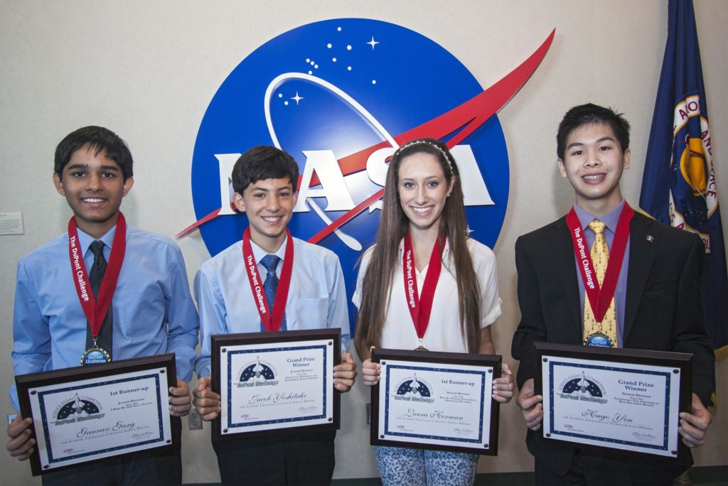 CAPE CANAVERAL, Fla. – The winning students of the 2013 DuPont Challenge Science Essay Competition show off their awards after a ceremony at the Kennedy Space Center Visitor Complex in Florida. From left are Junior Division first runner-up Gaurav Garg of Beckendorff Junior High in Katy, Texas Senior Division grand prize winner Jacob Yoshitake of Marshall Middle School in San Diego, Calif. Senior Division first runner-up Laura Herman of Pine Crest School in Fort Lauderdale, Fla. and Senior Division grand prize awardee Hugo Yen of Troy High in Fullerton, Calif. and Marc Doyle, Dupont's global marketing and product director. The challenge, now in its 27th year, reaches out to students from grades seven through 12 from all 50 states and Canada. More than 200,000 students entered the competition. The DuPont Challenge aims to inspire students to excel and achieve in scientific writing and pursue careers in science, technology, engineering and mathematics STEM. The challenge honors space shuttle Challenger's STS-51L crew members who gave their lives while furthering the cause of exploration and discovery. For more information on the challenge, go to http://thechallenge.dupont.com/sponsors/nasa.php. KSC-2013-2211