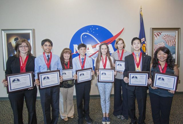 CAPE CANAVERAL, Fla. -  The winning students and their teachers of the 2013 DuPont Challenge Science Essay Competition show off their awards after a ceremony at the Kennedy Space Center Visitor Complex in Florida. From left are sponsoring teacher Angela Weeks and Junior Division first runner-up Gaurav Garg of Beckendorff Junior High in Katy, Texas sponsoring teacher Elaine Gillum and Senior Division grand prize winner Jacob Yoshitake of Marshall Middle School in San Diego, Calif. Senior Division first runner-up Laura Herman and sponsoring teacher Jennifer Gordinier of Pine Crest School in Fort Lauderdale, Fla. and Senior Division grand prize awardee Hugo Yen and sponsoring teacher Nga Ngo of Troy High in Fullerton, Calif. The challenge, now in its 27th year, reaches out to students from grades seven through 12 from all 50 states and Canada. More than 200,000 students entered the competition. The DuPont Challenge aims to inspire students to excel and achieve in scientific writing and pursue careers in science, technology, engineering and mathematics STEM. The challenge honors space shuttle Challenger's STS-51L crew members who gave their lives while furthering the cause of exploration and discovery. For more information on the challenge, go to http://thechallenge.dupont.com/sponsors/nasa.php. KSC-2013-2212