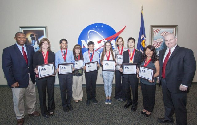 CAPE CANAVERAL, Fla. - The winning students and their teachers of the 2013 DuPont Challenge Science Essay Competition show off their awards after a ceremony at the Kennedy Space Center Visitor Complex in Florida. From left are, Kelvin Manning, the center's associate deputy director sponsoring teacher Angela Weeks and Junior Division first runner-up Gaurav Garg of Beckendorff Junior High in Katy, Texas sponsoring teacher Elaine Gillum and Senior Division grand prize winner Jacob Yoshitake of Marshall Middle School in San Diego, Calif. Senior Division first runner-up Laura Herman and sponsoring teacher Jennifer Gordinier of Pine Crest School in Fort Lauderdale, Fla. and Senior Division grand prize awardee Hugo Yen and sponsoring teacher Nga Ngo of Troy High in Fullerton, Calif. The challenge, now in its 27th year, reaches out to students from grades seven through 12 from all 50 states and Canada. More than 200,000 students entered the competition. The DuPont Challenge aims to inspire students to excel and achieve in scientific writing and pursue careers in science, technology, engineering and mathematics STEM. The challenge honors space shuttle Challenger's STS-51L crew members who gave their lives while furthering the cause of exploration and discovery. For more information on the challenge, go to http://thechallenge.dupont.com/sponsors/nasa.php. KSC-2013-2213