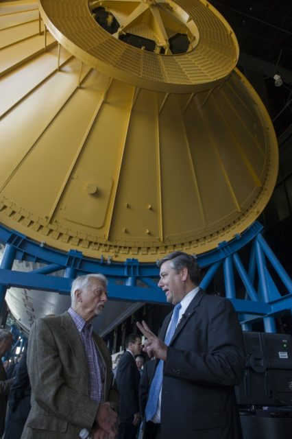 MARSHALL CENTER DIRECTOR PATRICK SCHEUERMANN, RIGHT, TALKS WITH FORMER ASTRONAUT OWEN GARRIOTT BENEATH THE SATURN V ROCKET SUSPENDED IN THE DAVIDSON CENTER FOR SPACE EXPLORATION AT THE U.S. SPACE & ROCKET CENTER 1300308