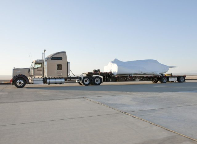 EDWARDS, Calif. – ED13-0142-11: The truck and trailer that transported the Dream Chaser engineering test article from Sierra Nevada Corporation, or SNC, Space Systems facility in Louisville, Colo., arrives on the aircraft ramp at NASA's Dryden Flight Research Center on Edwards Air Force Base, Calif., early in the morning. Based on NASA's HL-20 lifting body design, the Dream Chaser will begin its approach-and-landing flight test program in collaboration with NASA's Commercial Crew Program this summer.    SNC is one of three companies working with NASA's Commercial Crew Program, or CCP, during the agency's Commercial Crew Integrated Capability, or CCiCap, initiative, which is intended to lead to the availability of commercial human spaceflight services for government and commercial customers. To learn more about CCP and its industry partners, visit www.nasa.gov/commercialcrew. Image credit: NASA/Tom Tschida KSC-2013-2361