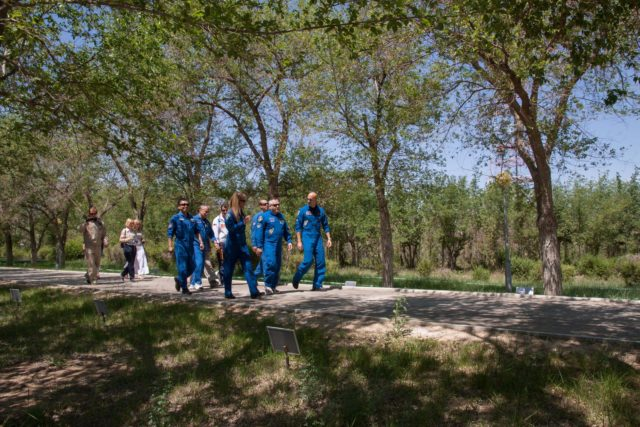 Behind their Cosmonaut Hotel crew quarters in Baikonur, Kazakhstan, the Expedition 36/37 prime and backup crewmembers take a stroll down the tree-lined Walk of Cosmonauts May 22. From left to right are backup Flight Engineer Koichi Wakata of the Japan Aerospace Exploration Agency, backup Soyuz Commander Mikhail Tyurin, prime Flight Engineer Karen Nyberg of NASA, backup Flight Engineer Rick Mastracchio of NASA, prime Soyuz Commander Fyodor Yurchikhin and prime Flight Engineer Luca Parmitano of the European Space Agency. Nyberg, Yurchikhin and Parmitano are preparing for their launch May 29, Kazakh time, in the Soyuz TMA-09M spacecraft to begin a 5 ½ month mission on the International Space Station.  NASA/Victor Zelentsov jsc2013e048269