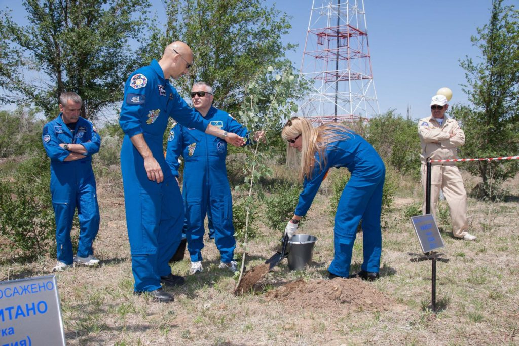 Behind the Cosmonaut Hotel crew quarters in Baikonur, Kazakhstan, Expedition 36/37 Flight Engineer Karen Nyberg of NASA plants a tree in her name in a traditional ceremony May 22 as backup crewmember Mikhail Tyurin (left), prime Flight Engineer Luca Parmitano of the European Space Agency (second from left) and prime Soyuz Commander Fyodor Yurchikhin look on. Nyberg, Yurchikhin and Parmitano are preparing for their launch May 29, Kazakh time, in the Soyuz TMA-09M spacecraft to begin a 5 ½ month mission on the International Space Station.  NASA/Victor Zelentsov jsc2013e048271