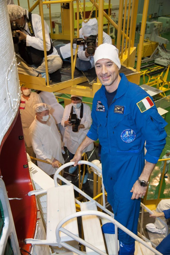 """At the Baikonur Cosmodrome in Kazakhstan, Expedition 36/37 Flight Engineer Luca Parmitano of the European Space Agency boards the Soyuz TMA-09M spacecraft in the Integration Facility May 24 in support of the final """"fit check"""" dress rehearsal by the prime and backup crews. Parmitano, and his crewmates, Flight Engineer Karen Nyberg of NASA and Soyuz Commander Fyodor Yurchikhin are preparing for launch May 29, Kazakh time, in the Soyuz to begin a 5 ½ month mission on the International Space Station.  NASA/Victor Zelentsov jsc2013e048418"""