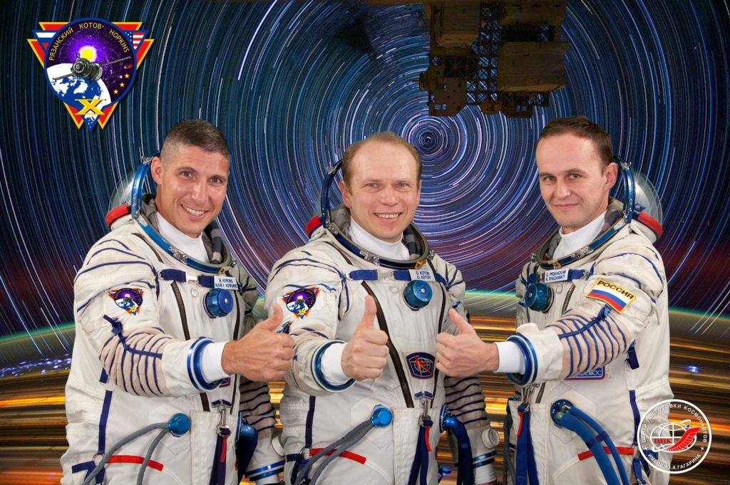 JSC2013-E-076004 (20 June 2013) --- Russian cosmonaut Oleg Kotov (center), Expedition 37 flight engineer and Expedition 38 commander; along with NASA astronaut Michael Hopkins (left) and Russian cosmonaut Sergey Ryazanskiy, both Expedition 37/38 flight engineers, attired in Russian Sokol launch and entry suits, take a break from training in Star City, Russia to pose for a crew portrait. Photo credit: Gagarin Cosmonaut Training Center jsc2013e076004