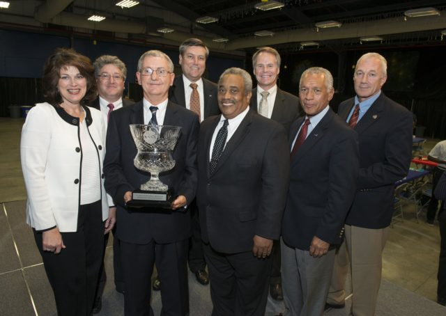 NASA ADMINISTRATOR CHARLES BOLDEN PRESENTS CENTER LEADERS WITH THE SMALL BUSINESS ADMINISTRATOR'S CUP.  PARTICIPATING IN THE AWARD CEREMONY WERE, FROM LEFT, MARSHALL ASSOCIATE DIRECTOR ROBIN HENDERSON, DAVID IOSCO, DEPUTY DIRECTOR OF MARSHALL'S OFFICE OF PROCUREMENT; MARSHALL SMALL BUSINESS SPECIALIST DAVID BROCK; MARSHALL CENTER DIRECTOR PATRICK SCHEUERMANN; GLENN DELGADO, ASSOCIATE ADMINISTRATOR OF NASA'S OFFICE OF SMALL BUSINESS PROGRAMS; KIM WHITSON, DIRECTOR OF MARSHALL'S OFFICE OF PROCUREMENT; NASA ADMINISTRATOR CHARLES BOLDEN; AND TERRY WILCUTT, ASSOCIATE ADMINISTRATOR OF NASA'S OFFICE OF SAFETY AND MISSION ASSURANCE. 1300563