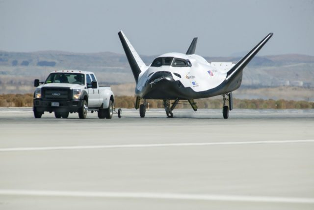 Edwards, Calif. – ED13-0266-047- A pickup truck pulls the Sierra Nevada Corporation, or SNC, Dream Chaser flight vehicle through 60 mile per hour tow tests on taxi and runways at NASA's Dryden Flight Research Center at Edwards Air Force Base in California. Ground testing at 10, 20, 40 and 60 miles per hour is helping the company validate the performance of the spacecraft's braking and landing systems prior to captive-carry and free-flight tests scheduled for later this year.              SNC is continuing the development of its Dream Chaser spacecraft under the agency's Commercial Crew Development Round 2, or CCDev2, and Commercial Crew Integrated Capability, or CCiCap, phases, which are intended to lead to the availability of commercial human spaceflight services for government and commercial customers. To learn more about CCP and its industry partners, visit www.nasa.gov/commercialcrew. Image credit: NASA/Ken Ulbrich KSC-2013-3232