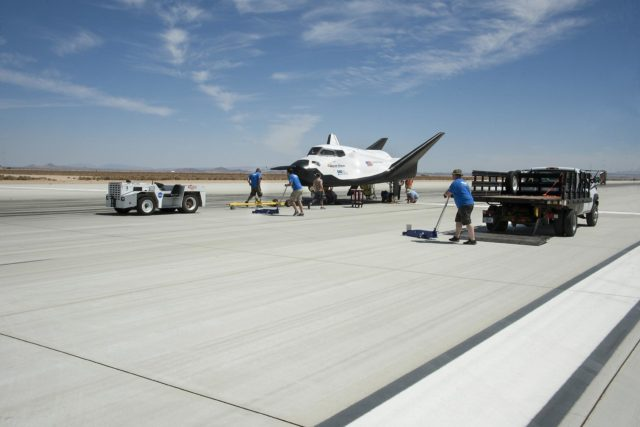 Edwards, Calif. – ED13-0266-069- Sierra Nevada Corporation, or SNC, team members check the company's Dream Chaser flight vehicle systems following a 60 mph tow test on taxi and runways at NASA's Dryden Flight Research Center at Edwards Air Force Base in California. Ground testing at 10, 20, 40 and 60 miles per hour is helping the company validate the performance of the spacecraft's braking and landing systems prior to captive-carry and free-flight tests scheduled for later this year.          SNC is continuing the development of its Dream Chaser spacecraft under the agency's Commercial Crew Development Round 2, or CCDev2, and Commercial Crew Integrated Capability, or CCiCap, phases, which are intended to lead to the availability of commercial human spaceflight services for government and commercial customers. To learn more about CCP and its industry partners, visit www.nasa.gov/commercialcrew. Image credit: NASA/Ken Ulbrich KSC-2013-3309