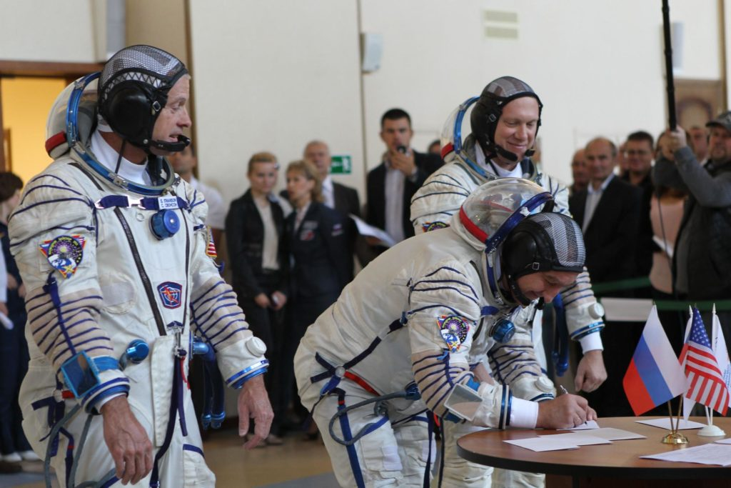 At the Gagarin Cosmonaut Training Center in Star City, Russia, Expedition 37/38 backup Soyuz Commander Alexander Skvortsov (center) signs in Sept. 3 to initiate a round of qualification exams as his backup crewmates, NASA Flight Engineer Steve Swanson (left) and Flight Engineer Oleg Artemyev (right) look on. The trio is serving as backups to the prime crew – Soyuz Commander Oleg Kotov, Flight Engineer Sergey Ryazanskiy and Flight Engineer Michael Hopkins of NASA -- who will launch to the International Space Station Sept. 26 in their Soyuz TMA-10M spacecraft from the Baikonur Cosmodrome in Kazakshtan. NASA/Stephanie Stoll jsc2013e079230