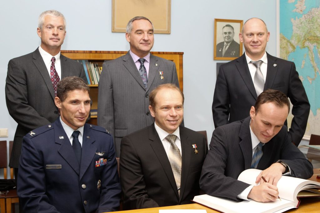 At the Gagarin Cosmonaut Training Center in Star City, Russia, Expedition 37/38 Flight Engineer Sergey Ryazanskiy (right, front row) signs a certification book in a traditional ceremony Sept. 6 as his prime and backup crewmates look on. In the front row are prime crewmates NASA Flight Engineer Michael Hopkins (left) and Soyuz Commander Oleg Kotov (center). In the back row are backup crewmembers Steve Swanson of NASA (left), Alexander Skvortsov (center) and Oleg Artemyev (right). Hopkins, Kotov and Ryazanskiy are preparing for their launch to the International Space Station from the Baikonur Cosmodrome in Kazakhstan on Sept. 26, Kazakh time, aboard the Soyuz TMA-10M spacecraft.  NASA/Stephanie Stoll jsc2013e080228