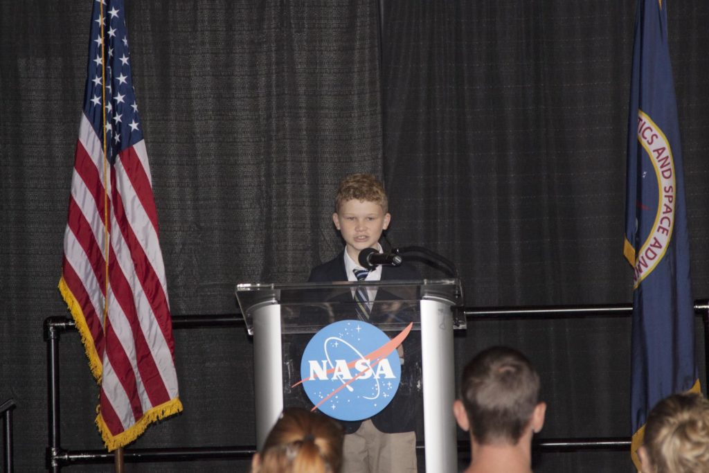 """CAPE CANAVERAL, Fla. -- At the Kennedy Space Center Visitor Complex in Florida, Patrick Sullivan spoke on behalf of the Space Exploration Ambassadors during a ceremony to enshrine a Space Shuttle Program time capsule in a secured vault within the walls of the Space Shuttle Atlantis home at the Kennedy Space Center Visitor Complex. Sullivan's remarks focused on the missions of shuttle Atlantis, the final launch day -- which he attended -- and the future of the space program.      The time capsule, containing artifacts and other memorabilia associated with the history of the program is designated to be opened on the 50th anniversary of the shuttle's final landing, STS-135. The new $100 million """"Space Shuttle Atlantis"""" facility includes interactive exhibits that tell the story of the 30-year Space Shuttle Program and highlight the future of space exploration. Photo credit: NASA/Jim Grossmann KSC-2013-3516"""