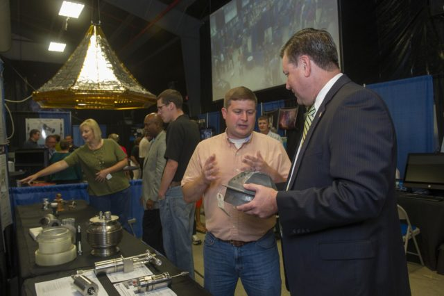 MARSHALL CENTER DIRECTOR PATRICK SCHEUERMANN, RIGHT, DISCUSSES THE FINER POINTS OF USING ADDITIVE MANUFACTURING TO BUILD ENGINE PARTS WITH DAVID EDDLEMAN, A COMPONENT ENGINEER WITH THE ENGINEERING DIRECTORATE, DURING INNOVATION & TECHNOLOGY DAY 1301005