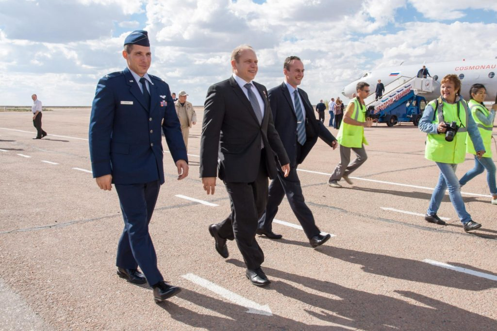 Expedition 37/38 Flight Engineer Michael Hopkins of NASA (left), Soyuz Commander Oleg Kotov (center) and Flight Engineer Sergey Ryazanskiy (right) walk to ground transportation at an airport in Baikonur, Kazakhstan near the launch site at the Baikonur Cosmodrome Sept. 13 following a flight from their training base outside of Moscow.  Hopkins, Kotov and Ryazanskiy will launch from Baikonur Sept. 26, Kazakh time, in the Soyuz TMA-10M spacecraft for a five and a half month mission on the International Space Station.  NASA/Victor Zelentsov jsc2013e087548