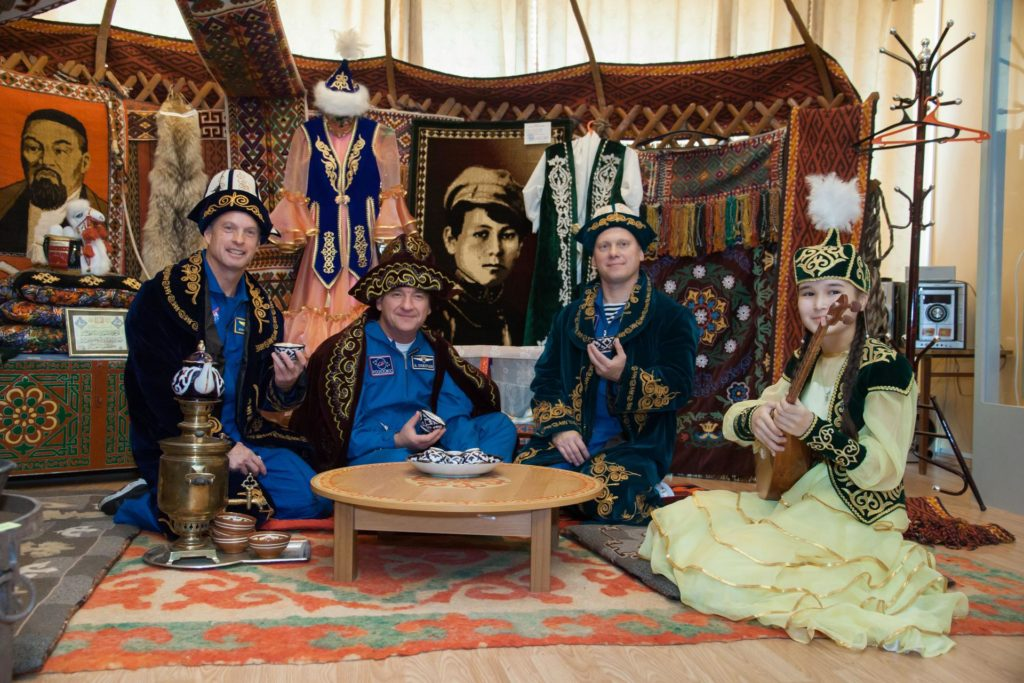 Dressed in traditional Kazakh garb, Expedition 37/38 backup crewmembers Steve Swanson of NASA (left), Alexander Skvortsov (center) and Oleg Artemyev (right) enjoy festivities and a Kazakh meal in Baikonur, Kazakhstan Sept. 17. Swanson, Skvortsov and Artemyev are serving as backups to the prime crewmembers, Flight Engineer Michael Hopkins of NASA, Soyuz Commander Oleg Kotov and Flight Engineer Sergey Ryazanskiy, who are preparing for launch Sept. 26, Kazakh time from the Baikonur Cosmodrome in the Soyuz TMA-10M spacecraft for a five and a half month mission on the International Space Station.  NASA/Victor Zelentsov jsc2013e087840