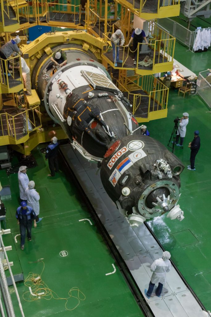 In the Integration Facility at the Baikonur Cosmodrome in Kazakhstan, the Soyuz TMA-10M spacecraft is readied for its encapsulation in the third stage of a Soyuz rocket Sept. 19. The Soyuz spacecraft will move to its launch pad Sept. 23 for final preparations for launch Sept. 26, Kazakh time, to carry Expedition 37/38 Flight Engineer Michael Hopkins of NASA, Soyuz Commander Oleg Kotov and Flight Engineer Sergey Ryazanskiy into orbit for the start of a five and a half month mission on the International Space Station.  NASA/Victor Zelentsov jsc2013e088069