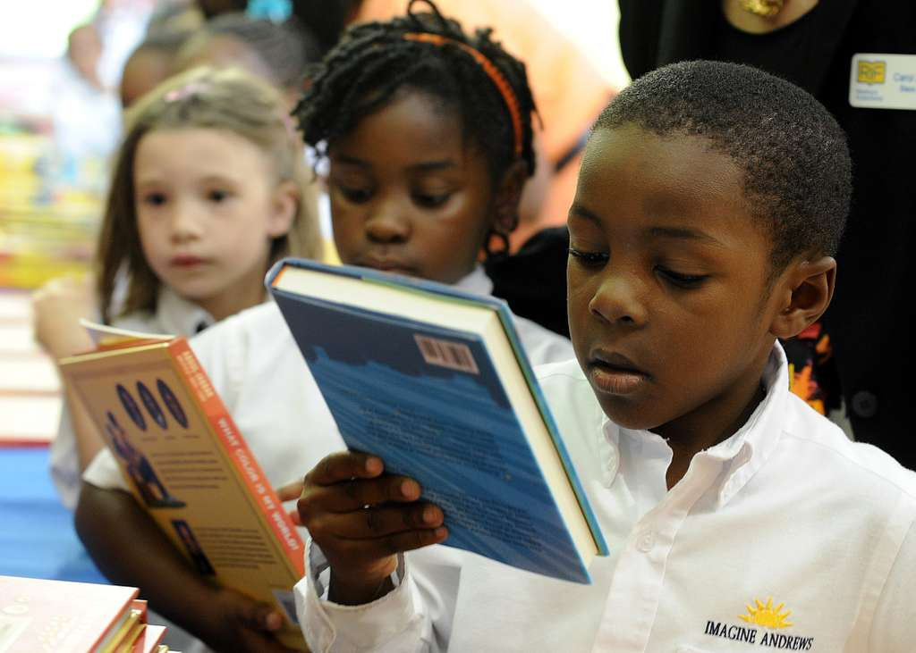 Children receive books during a Reading is Fundamental