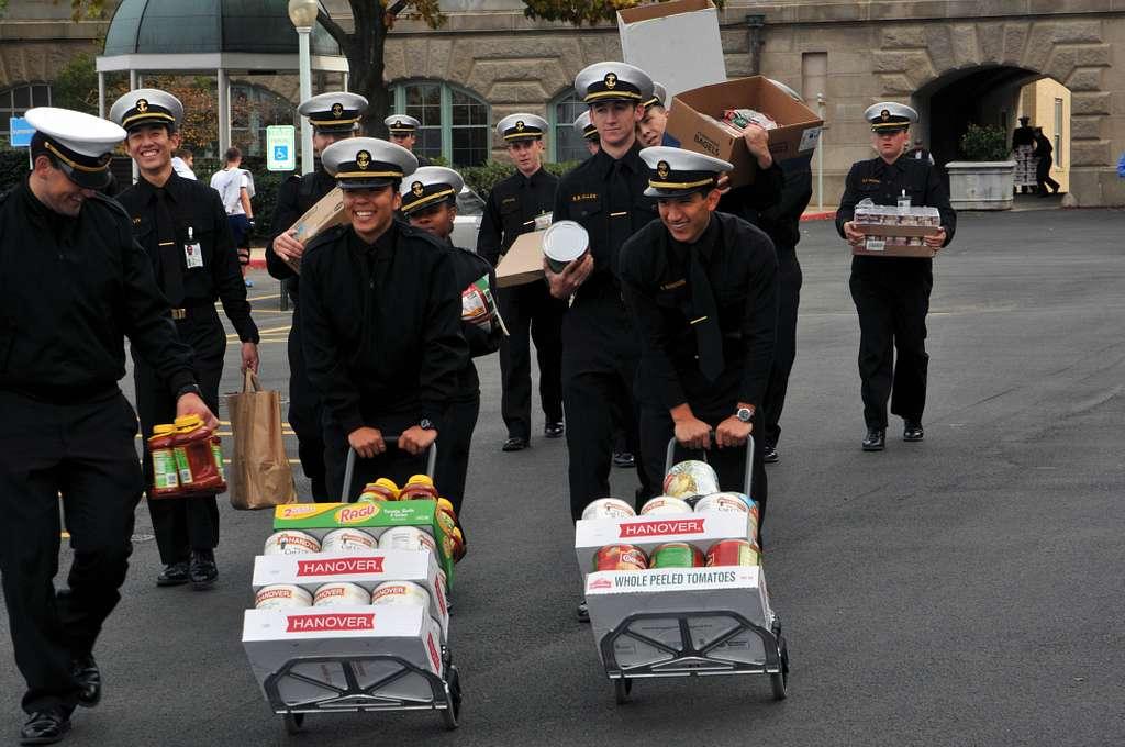 Midshipmen deliver nonperishable food to the parking