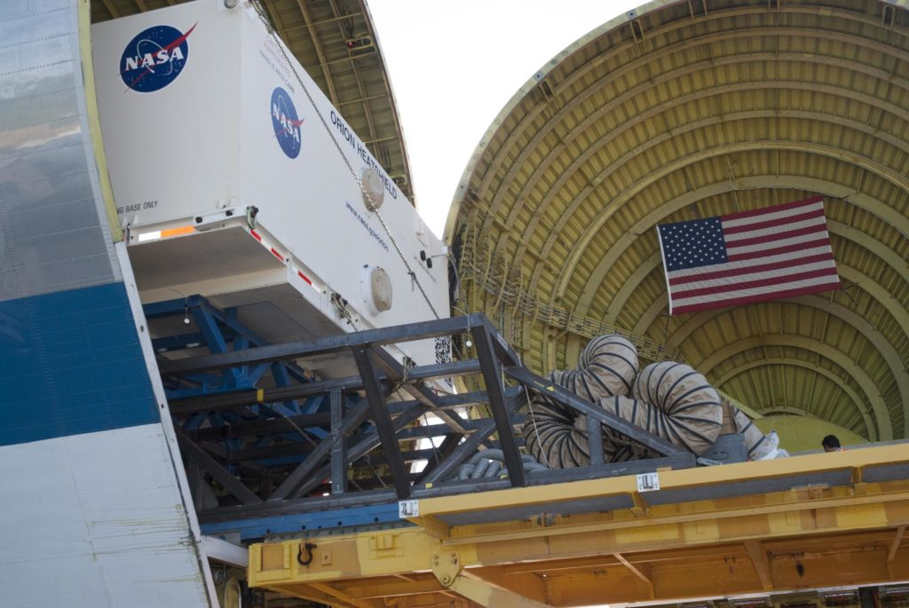CAPE CANAVERAL, Fla. – At the Shuttle Landing Facility at NASA's Kennedy Space Center in Florida, the heat shield for the agency's Orion spacecraft is being offloaded from the Super Guppy aircraft. The largest of its kind ever built, the heat shield is planned for installation on the Orion crew module in March of next year. The Orion spacecraft is scheduled to make its first unpiloted flight test, Exploration Flight Test-1 EFT-1, in September 2014.    The Orion spacecraft is designed to meet requirements for traveling beyond low-Earth orbit. The spacecraft will serve as the exploration vehicle that will carry crews to space, sustain the astronauts during the space travel and provide safe re-entry from deep space. For more information, visit: http://www.nasa.gov/orion Photo credit: NASA/Charisse Nasher KSC-2013-4248