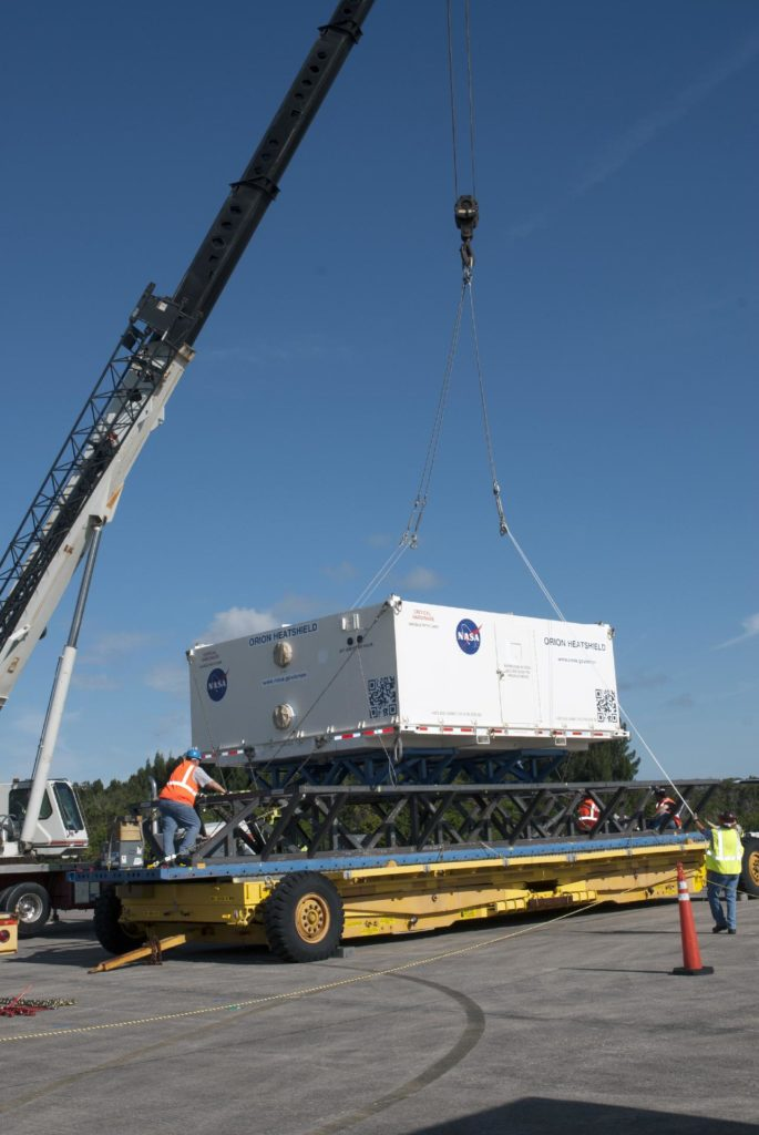 CAPE CANAVERAL, Fla. – At the Shuttle Landing Facility at NASA's Kennedy Space Center in Florida, the heat shield for the agency's Orion spacecraft has been offloaded from the Super Guppy aircraft and a crane is loading it on to a transport truck. The largest of its kind ever built, the heat shield is planned for installation on the Orion crew module in March of next year. The Orion spacecraft is scheduled to make its first unpiloted flight test, Exploration Flight Test-1 EFT-1, in September 2014.        The Orion spacecraft is designed to meet requirements for traveling beyond low-Earth orbit. The spacecraft will serve as the exploration vehicle that will carry crews to space, sustain the astronauts during the space travel and provide safe re-entry from deep space. For more information, visit: http://www.nasa.gov/orion Photo credit: NASA/Charisse Nasher KSC-2013-4251