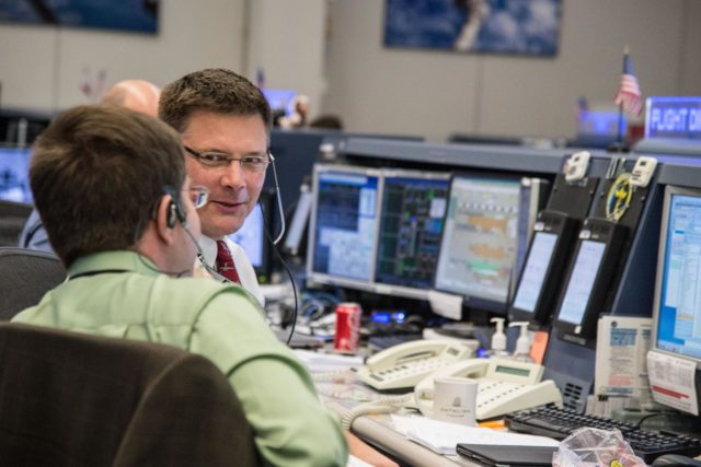 DATE: 3-27-14.LOCATION: Bldg. 30 - FCR-1 (30M/231).SUBJECT: Expedition 39 flight controllers on console with Flight Director Ron Spencer watch the approach of the Soyuz 39 crew docking to the ISS from FCR-1..PHOTOGRAPHER: Lauren Harnett jsc2014e031517