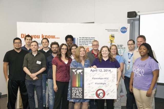 CAPE CANAVERAL, Fla. - Members of the winning Astronaut Resource Managing System and SpaceWear teams in the International Space Apps Challenge pose for a group portrait with the NASA volunteers, judges and event organizers. From left are Alejandro Velasco, NASA's Justin Treptow, Sam Neblett, Roberto Ricci, James Brucato, NASA's Suzanne Plantec, Keith Hargett, NASA's Cynthia Duffaut, NASA's Launa Maier, event organizer James Wood, event organizer lead Caley Burke, NASA's Lisa Singleton, event organizer David Miranda, NASA Ground Systems Development and Operation Program Manager Michael Bolger and NASA intern Brandi Burse.      Kennedy Space Center hosted one of the over 90 locations around the world where participants congregated for the attempt to design innovative solutions for global challenges over a 48-hour period. This year's development marathon focused on five NASA mission areas: Asteroids, Earth Watch, Human Spaceflight, Robotics, and Technology in Space. Three of this year's challenges were developed by KSC employees: Space Wearables: Fashion Designer to Astronauts, Growing Food for a Martian Table, and Asteroid Prospector. The winners selected in 2014 at Kennedy were Astronaut Resource Managing System, or ARMS, for Best Use of Data and SpaceWear for Best Use of Hardware. ARMS also took the People's Choice Award. For more information, visit https://2014.spaceappschallenge.org.  Photo credit: NASA/Daniel Casper KSC-2014-2072