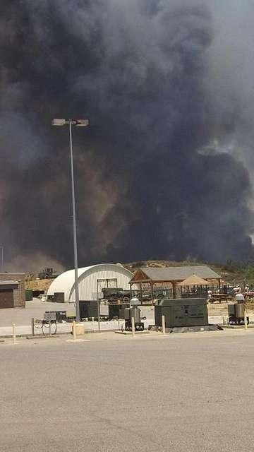 U.S. Marines and fire crew on Marine Corps Base Camp