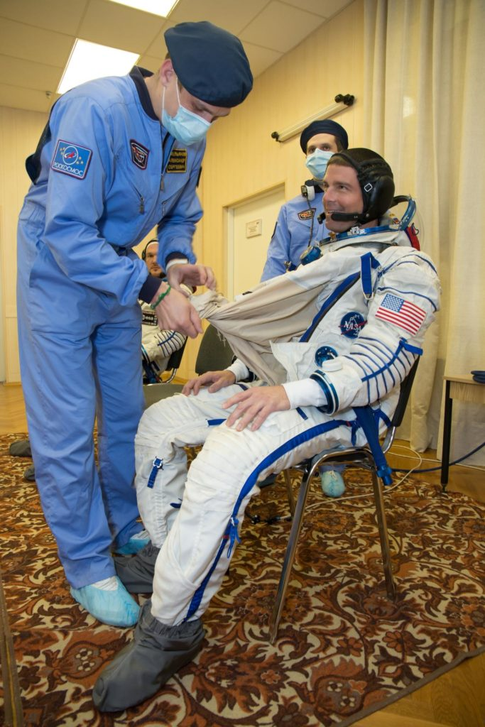 """12-14-07:  At the Baikonur Cosmodrome in Kazakhstan, Expedition 40/41 Flight Engineer Reid Wiseman of NASA suits up in his Russian Sokol launch and entry suit May 16 for a dress rehearsal """"fit check"""" in the Soyuz TMA-13M spacecraft. Wiseman, Soyuz Commander Max Suraev of the Russian Federal Space Agency (Roscosmos) and Flight Engineer Alexander Gerst of the European Space Agency will launch from Baikonur on May 29, Kazakh time, for a 5 ½ month mission on the International Space Station.  NASA/Victor Zelentsov jsc2014e049384"""