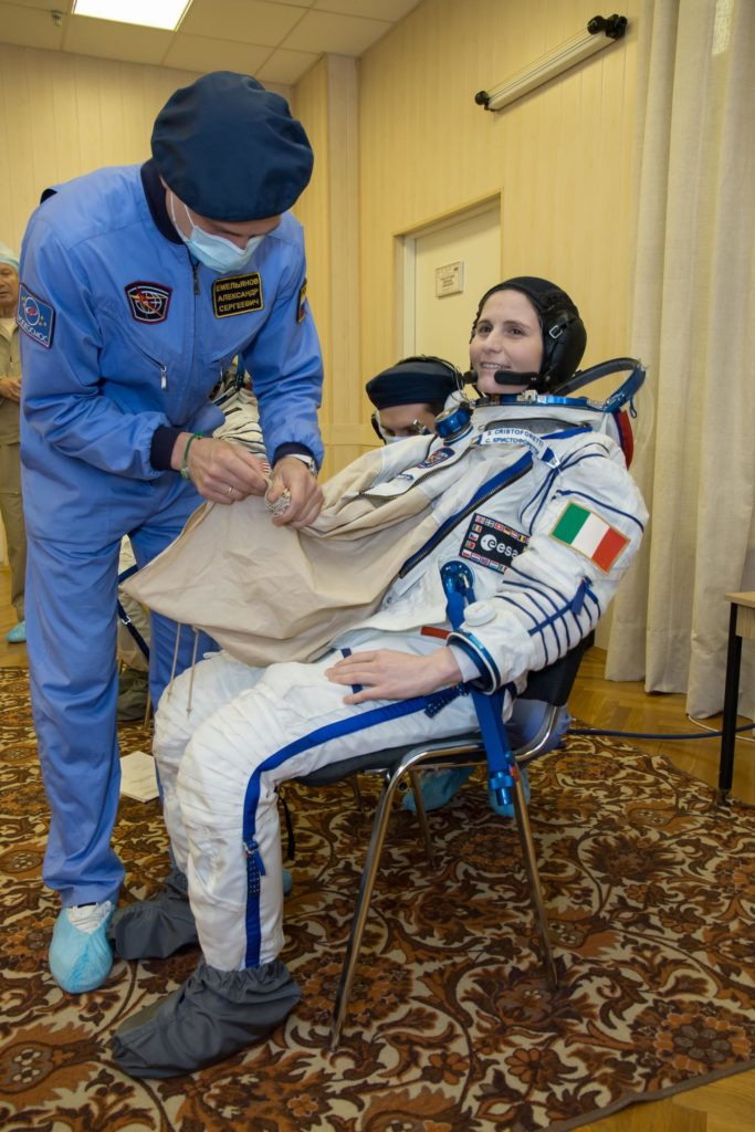 """15-02-29:  At the Baikonur Cosmodrome in Kazakhstan, Expedition 40/41 backup Flight Engineer Samantha Cristoforetti of the European Space Agency suits up in her Russian Sokol launch and entry suit May 16 for a dress rehearsal """"fit check"""" in the Soyuz TMA-13M spacecraft. Cristoforetti, NASA's Terry Virts and Anton Shkaplerov of the Russian Federal Space Agency (Roscosmos) are the backups to Flight Engineer Alexander Gerst of the European Space Agency, NASA Flight Engineer Reid Wiseman and Soyuz Commander Max Suraev of the Russian Federal Space Agency (Roscosmos), who will launch from Baikonur on May 29, Kazakh time, for a 5 ½ month mission on the International Space Station.  NASA/Victor Zelentsov jsc2014e049397"""