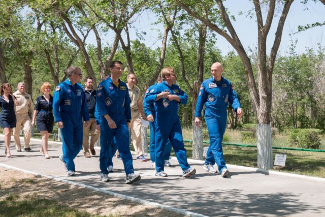 14-05-41-5:  At the Cosmonaut Hotel crew quarters in Baikonur, Kazakhstan, Expedition 40/41 Flight Engineer Reid Wiseman of NASA (front row, left), Soyuz Commander Max Suraev of the Russian Federal Space Agency (Roscosmos, front center) and Flight Engineer Alexander Gerst of the European Space Agency (front right) take a stroll down the Walk of Cosmonauts May 21 as part of their traditional pre-launch training ceremonies. Behind Wiseman is backup crewmember Terry Virts of NASA. Wiseman, Suraev and Gerst will launch on May 29, Kazakh time, on the Soyuz TMA-13M spacecraft from the Baikonur Cosmodrome for a 5 ½ month mission on the International Space Station.  NASA/Victor Zelentsov jsc2014e049630