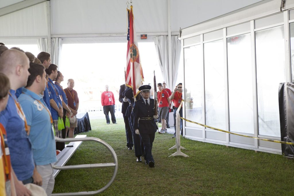 CAPE CANAVERAL, Fla. – Members of the West Virginia University color guard present the U.S. Flag during the opening ceremony of NASA's 2014 Robotics Mining Competition at the Kennedy Space Center Visitor Complex in Florida. More than 35 teams from around the U.S. have designed and built remote-controlled robots for the mining competition.    The competition is a NASA Human Exploration and Operations Mission Directorate project designed to engage and retain students in science, technology, engineering and mathematics, or STEM, fields by expanding opportunities for student research and design. Teams use their remote-controlled robotics to maneuver and dig in a supersized sandbox filled with a crushed material that has characteristics similar to Martian soil. The objective of the challenge is to see which team's robot can collect and move the most regolith within a specified amount of time. For more information, visit www.nasa.gov/nasarmc. Photo credit: NASA/Frankie Martin KSC-2014-2628