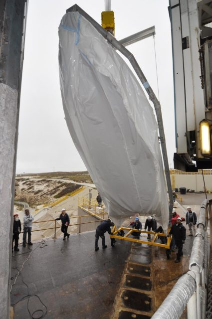 VANDENBERG AIR FORCE BASE, Calif. – A half section of the 10-foot-diameter fairing for NASA's Soil Moisture Active Passive mission, or SMAP, is lifted into a vertical position during preparations to hoist it into the environmental enclosure at the top of the mobile service tower at Space Launch Complex 2 on Vandenberg Air Force Base in California.    The fairing will protect the SMAP spacecraft from the heat and aerodynamic pressure generated during its ascent to orbit aboard a United Launch Alliance Delta II rocket. SMAP will provide global measurements of soil moisture and its freeze/thaw state. These measurements will be used to enhance understanding of processes that link the water, energy and carbon cycles, and to extend the capabilities of weather and climate prediction models. SMAP data will also be used to quantify net carbon flux in boreal landscapes and to develop improved flood prediction and drought monitoring capabilities. Launch is scheduled for no earlier than November 2014. To learn more about SMAP, visit http://smap.jpl.nasa.gov.  Photo credit: NASA/Randy Beaudoin KSC-2014-3468