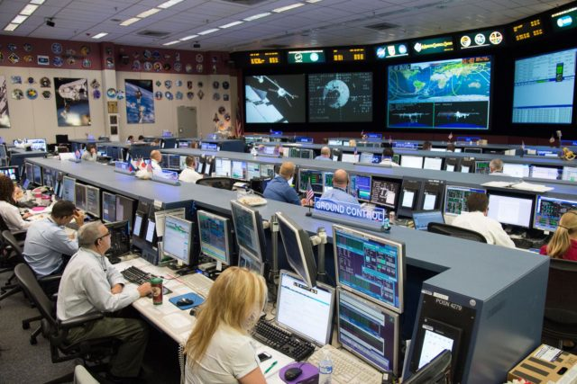 "DATE: 8-12-14 LOCATION: Bldg. 30 - FCR-1 (30M/231) SUBJECT: ISS Flight Controllers during docking of the ""Georges Lemaitre"" Automated Transfer Vehicle-5 to the aft port of the Zvezda Service Module. PHOTOGRAPHER: Lauren Harnett jsc2014e077199"