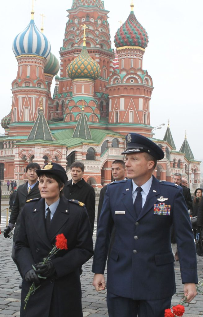 4064a:  In Red Square in Moscow, Expedition 42/43 crewmembers Samantha Cristoforetti of the European Space Agency (foreground, left) and Terry Virts of NASA (foreground, right) walk by the famed St. Basil's Cathedral Nov. 6 as they prepare to lay flowers at the Kremlin Wall where Russian space icons are interred. In the background are backup crewmembers Kimiya Yui of the Japan Aerospace Exploration Agency, Oleg Kononenko of the Russian Federal Space Agency (Roscosmos) and Kjell Lindgren of NASA. Cristoforetti, Virts and Anton Shkaplerov of Roscosmos will launch Nov. 24, Kazakh time from the Baikonur Cosmodrome in Kazakhstan on their Soyuz TMA-15M spacecraft for a 5 ½ month mission on the International Space Station.  NASA/Stephanie Stoll jsc2014e092327