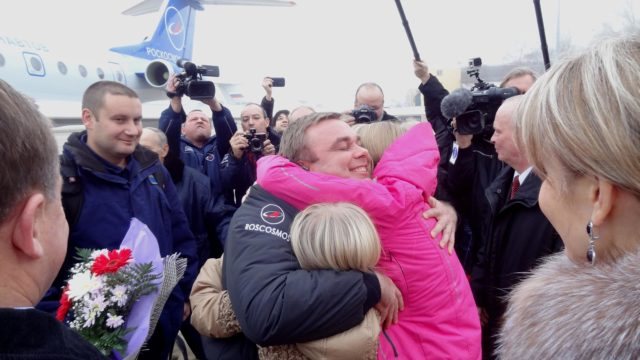 3490a: At Chkalovsky Airfield in Star City, Russia on the outskirts of Moscow, Expedition 41 Commander Max Suraev of the Russian Federal Space Agency (Roscosmos) is greeted by his daughters Nov. 10, just hours after he, NASA Flight Engineer Reid Wiseman and European Space Agency Flight Engineer Alexander Gerst landed in Kazakhstan in their Soyuz TMA-13M spacecraft to complete a 165-day mission on the International Space Station. Suraev completed his second flight in space and has now logged 334 days in space on his two missions.  NASA/Stephanie Stoll jsc2014e092491