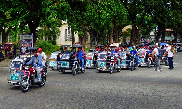 """Motorized tricycles.(Philippines"""""""