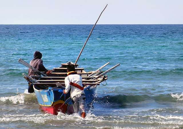 Launching the boat. Philippines.