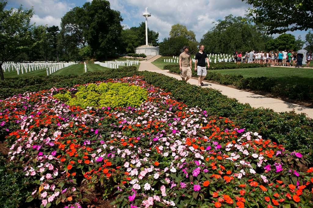 Flowers bloom in a garden near the Memorial Amphitheater