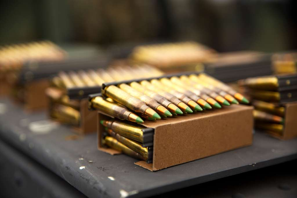 .556 ammunition lies stacked in preparation for use