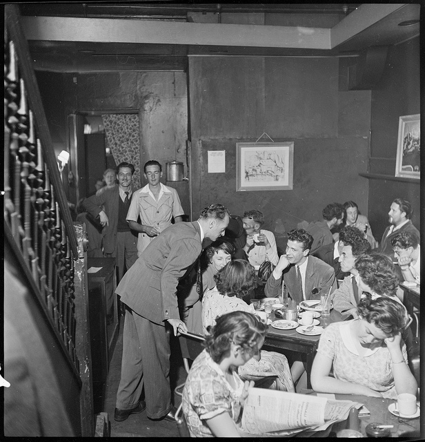 Piers Bourke (at rear, to right of corner) ; 'Johnno' Robert Johnson, student (to left of corner) ; Robert, Frenchman (with hand to chin), Michael Hourihan, in safari suit (near doorway) from Lincoln Coffee Lounge & Cafe, Rowe Street, Sydney / photographe